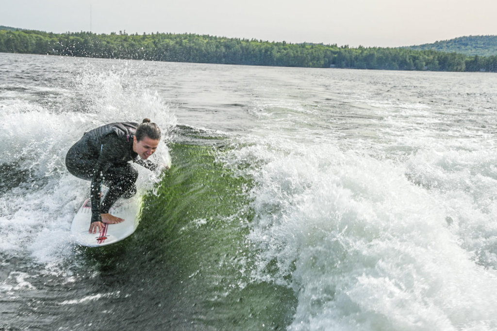 Our Store Manager Julia carves on a wake surf board.