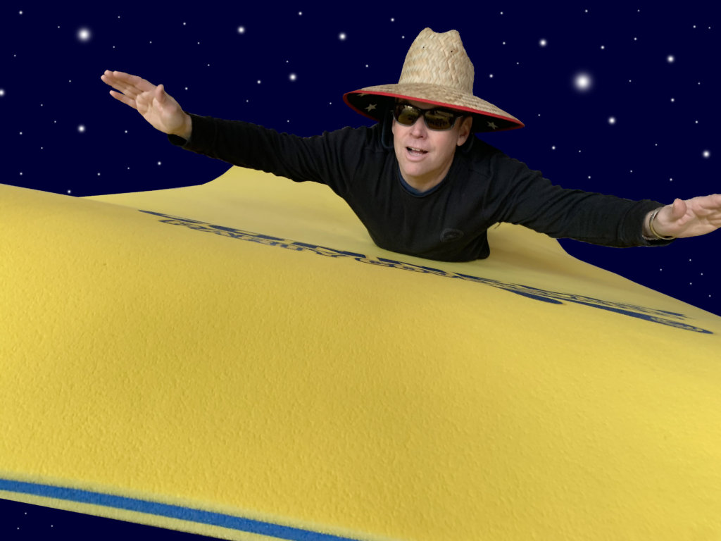 The Wake Wizard rides a Connelly Party Cove Water Carpet as if it were a magic carpet